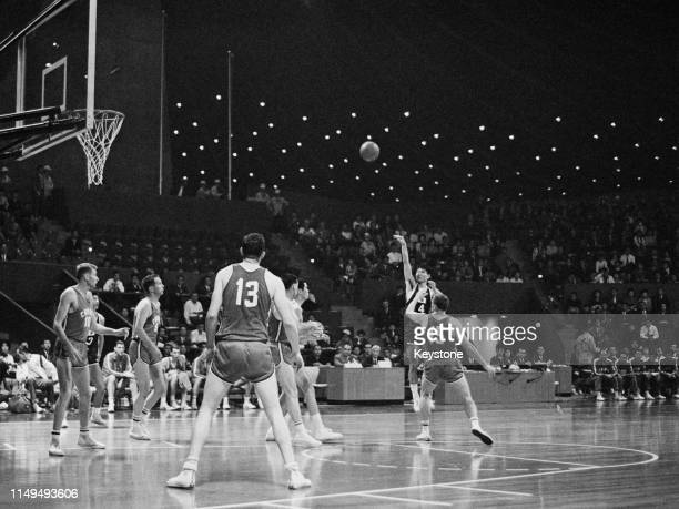 Setsuo Nara of Japan shoots against Canada during the Men's Olympic Basketball Tournament group A match on 13th October 1964 during the XVIII Summer...