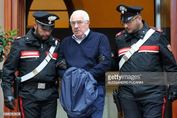 TOPSHOT Settimino Mineo jeweller and new head of the Sicilian mafia is escorted by carabinieri as he exits a police station after his arrest in...