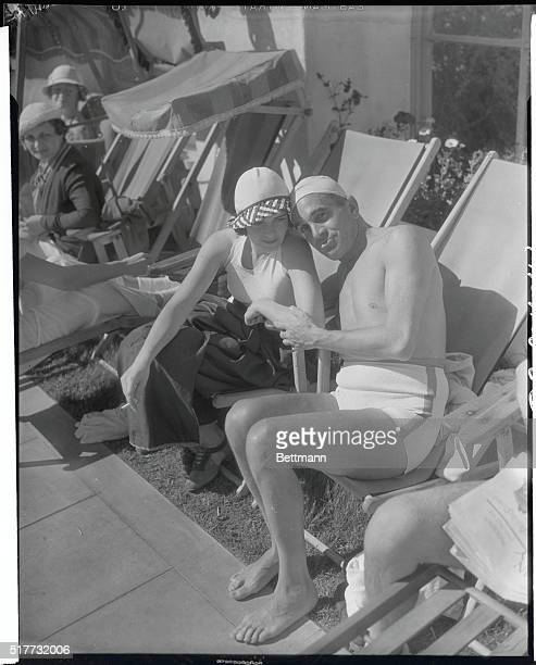 Setting a 'Golden' Sun Standard Weathering the bank holiday at Palm Springs Cal Al Jolson and his bride Ruby Keeler 'cash in' on the water sports...