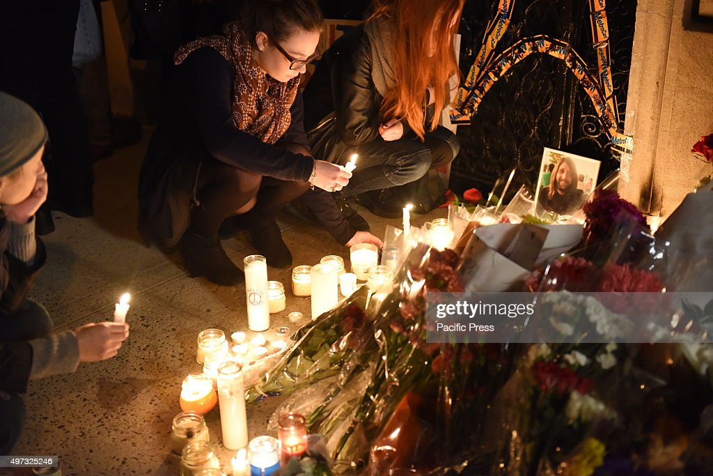 Setting out candles and flowers in front of the French consulate. A day that began with a rally at Washington Square Park culminated in a candlelight vigil outside the French consulate on the Upper East Side in memory of the victims of the Paris terror attacks.