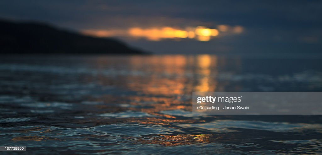 Setting sun at Totland Bay : Stock Photo