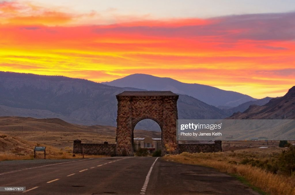 A Setting Sun Illuminates The Roosevelt Arch Which Frames The Northern Entrance To Yellowstone National Park High Res Stock Photo Getty Images