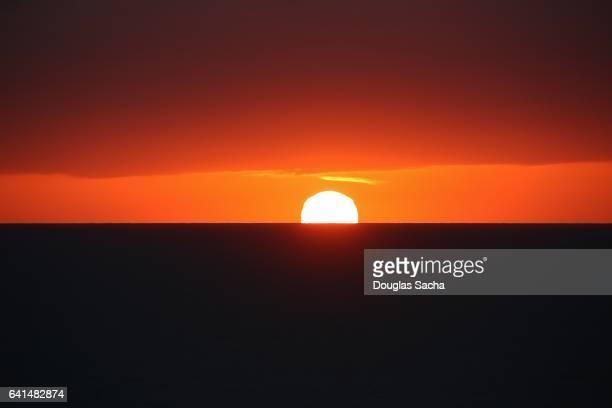 Setting sun light over the ocean horizon