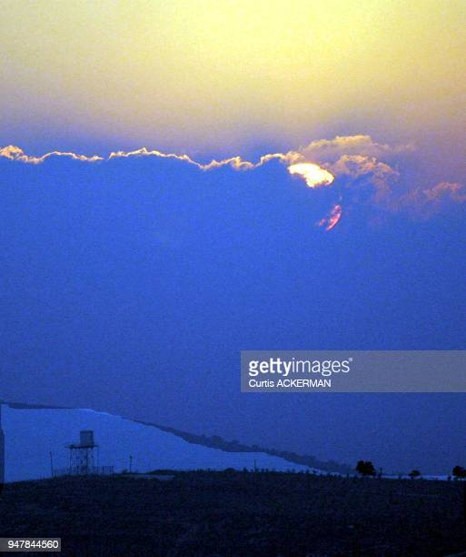 A setting sun over a Shilo settlement guard tower Shilo is a large West Bank settlement located north of Jerusalem was once a capital of the ancient...