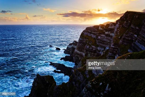 Setting sun over Kerry Cliffs along Skellig Ring outside Portmagee, western Ireland