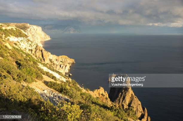setting sun over sea coast, crimea - argenberg stock pictures, royalty-free photos & images