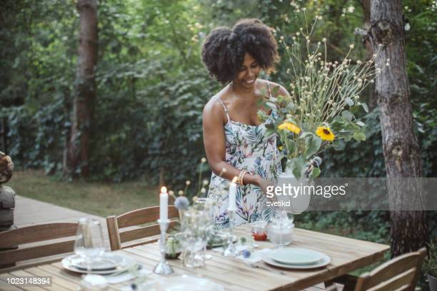 setting table for dinner outdoors - party decoration stock pictures, royalty-free photos & images
