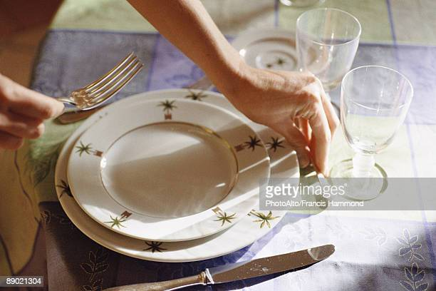 setting table - putting stock photos and pictures