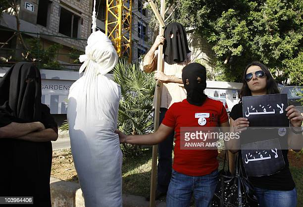 Setting up a mock gallows with a dummy on a rope about 25 Lebanese human rights activists protest outside the Saudi embassy in Beirut on April 1 2010...
