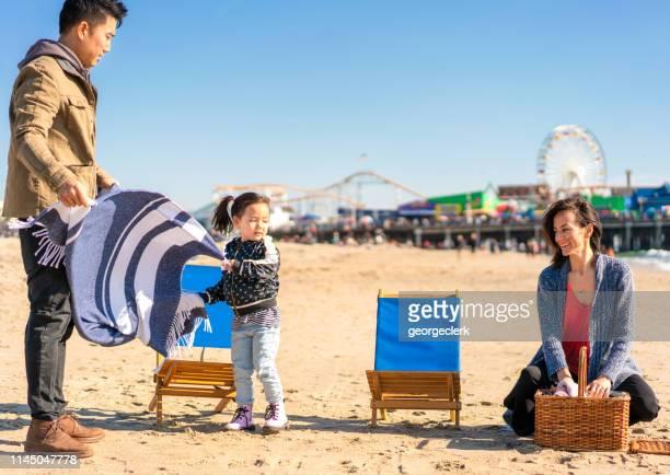 Setting up a picnic on Santa Monica beach