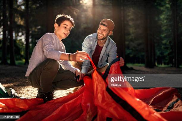 Setting up a tent in the forest
