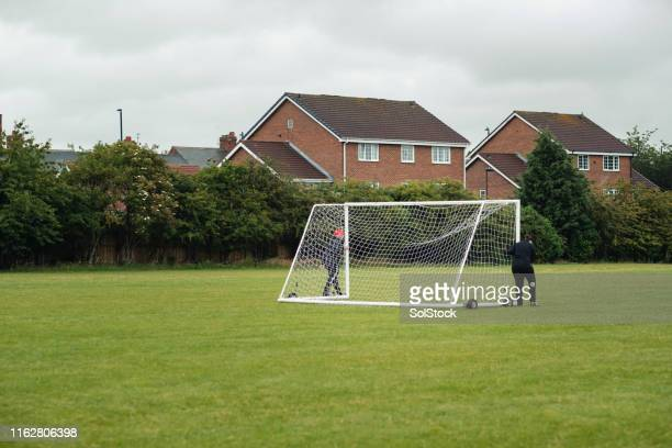setting up football net - sports equipment stock pictures, royalty-free photos & images