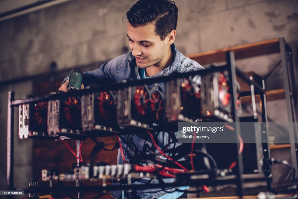 Setting up gear for mining bitcoin : Stock Photo