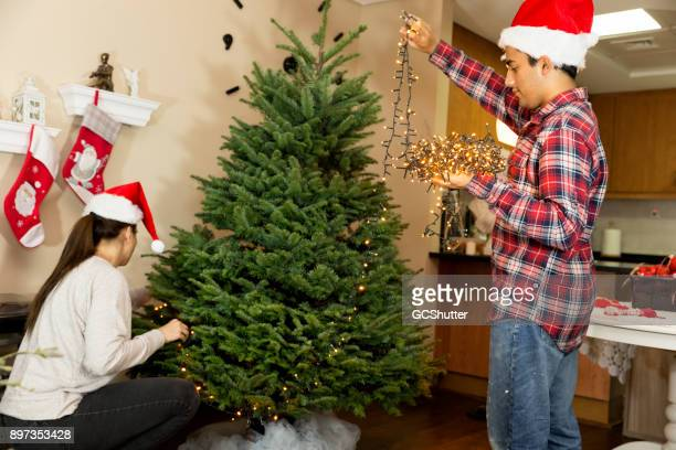 Setting up the tree at the side of the living room