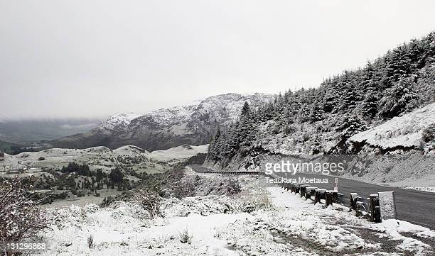 Settled snow is seen covering hills on New Zealand's lower South Island on November 4 2011 in Queenstown New Zealand The unseasonal weather is not...
