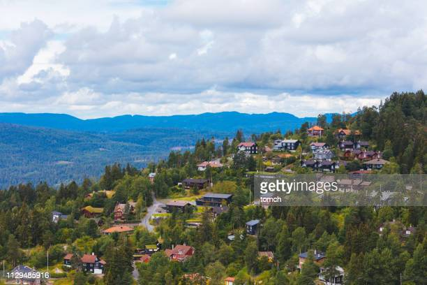 a settlement on a mountain slope in holmenkollen, oslo - hill stock pictures, royalty-free photos & images