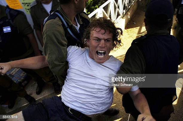 A settler protester is taken away by military police from the synagogue after it was raided August 18 2005 in the Israeli settlement of Neve Dekalim...