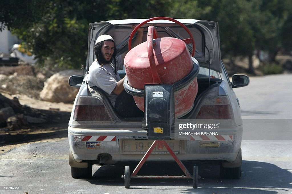 Moser A Settler Sits In The Trunk Of The Car As The Car Drags A