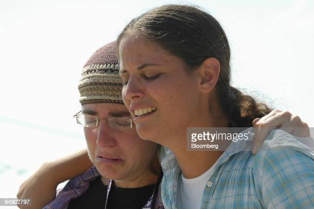Settlers from the Tel Katifa settlement react to their removal in the Gaza strip Israel Wednesday August 17 2005 Israel today began forcibly removing...