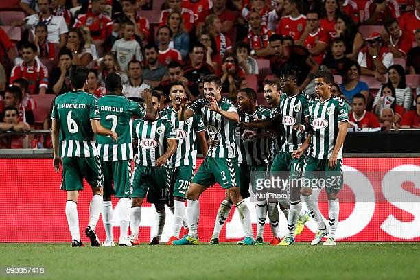 Setubal's defender Frederico Venancio celebrates his goal with his teammates during the Portuguese League football match between SL Benfica and...