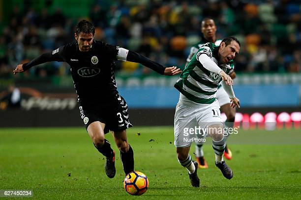 Setubal's defender Frederico Venancio vies for the ball with Sporting's forward Bruno Cesar during Premier League 2016/17 match between Sporting CP...