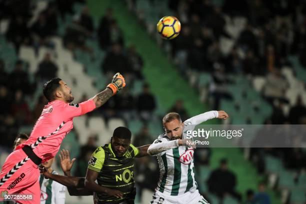 Setubal's goalkeeper Cristiano Pereira vies with Sporting's midfielder William Carvalho and Setubal's defender Pedro Pinto during the Portuguese...