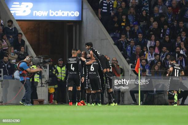 Setubals Portuguese midfielder Joao Carvalho celebrates after scoring a goal with team during the Premier League 2016/17 match between FC Porto and...