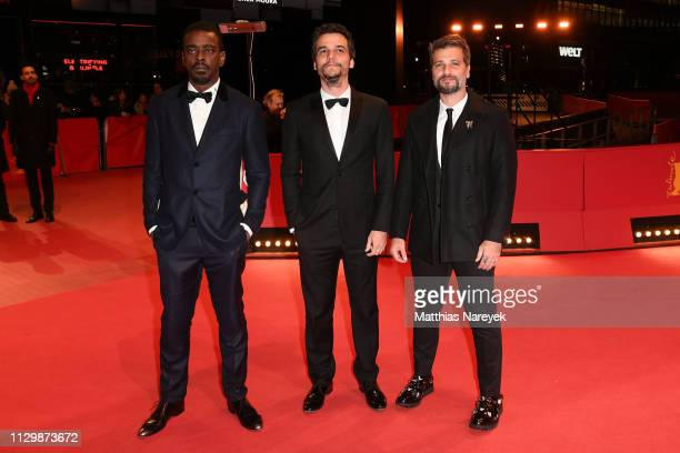 Seu Jorge Director Wagner Moura and Bruno Gagliasso pose at the Marighella premiere during the 69th Berlinale International Film Festival Berlin at...