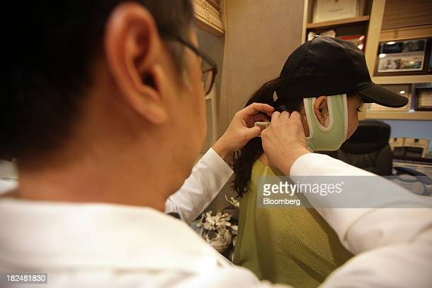 Seul Chul Hwan a doctor and head of JW Plastic Surgery checks a patient's postoperation condition in a consultation room at the clinic in the...