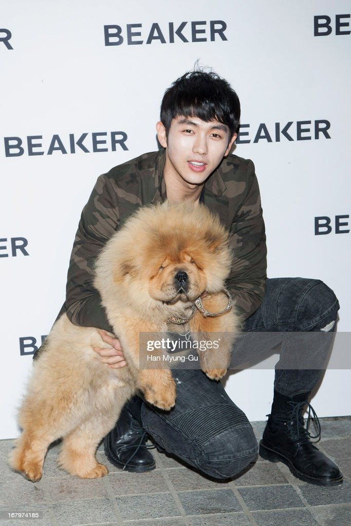 Seulong of South Korean boy band 2AM and his pet attends a promotional event for the 'BEAKER' Gangnam Flagship Store Opening on May 3, 2013 in Seoul, South Korea.