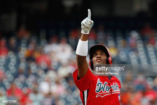 Seuly Matias of the Kansas City Royals and the World Team celebrates after scoring a run on a solo home run against the U.S. Team in the second...