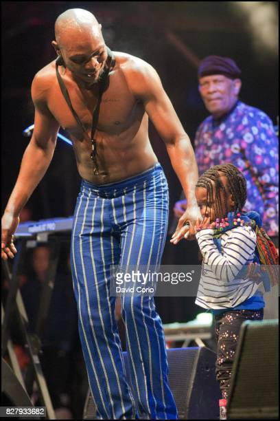 Seun Kuti and his daughter Ifafunmike Adara AnikulapoKuti and Roy Ayers at Womad Charlton Park Malmesbury Wiltshire UK on 30 July 2017