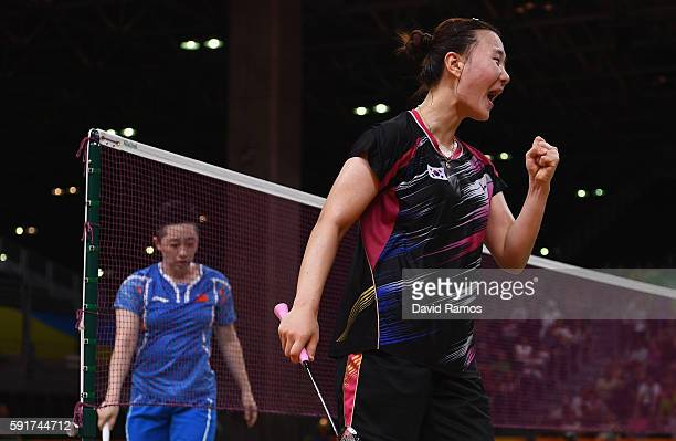 Seung Chan Shin of Republic of Korea celebrates winning a point against Yu Yang and Yuanting Tang of China during the Women's Badminton Double Bronze...