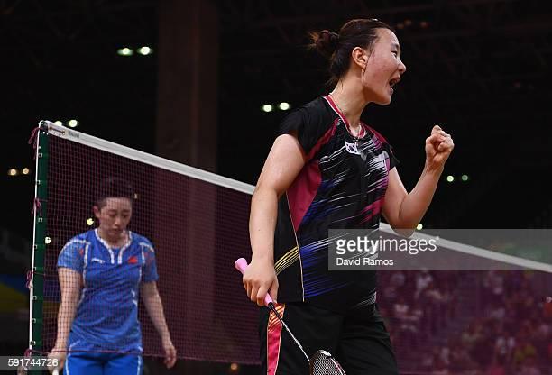 Seung Chan Shin ok Republic of Korea celebrates winning a point against Yu Yang and Yuanting Tang of China during the Women's Badminton Double Bronze...
