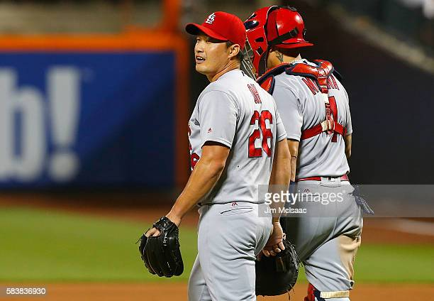 Seung Hwan Oh and Yadier Molina of the St Louis Cardinals celebrate after defeating the New York Mets at Citi Field on July 27 2016 in the Flushing...