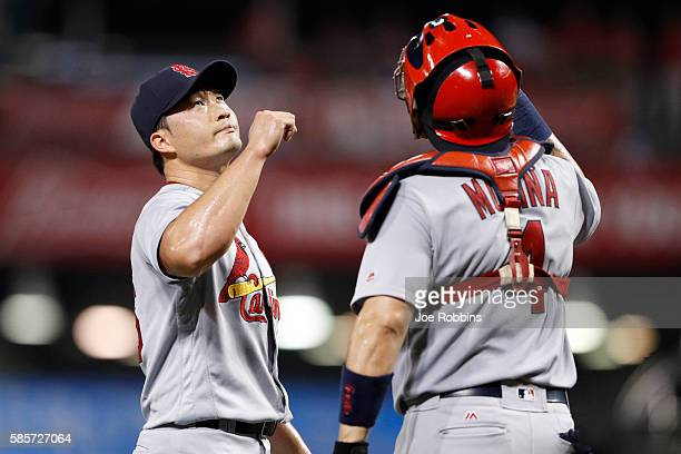 Seung Hwan Oh and Yadier Molina of the St Louis Cardinals celebrate after the final out in the ninth inning against the Cincinnati Reds at Great...