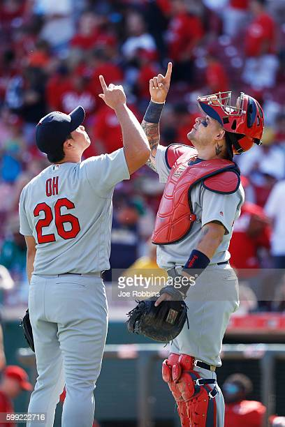 Seung Hwan Oh and Yadier Molina of the St Louis Cardinals celebrate after the final out against the Cincinnati Reds in the ninth inning at Great...
