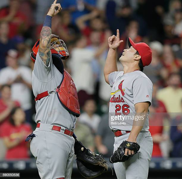 Seung Hwan Oh of the St Louis Cardinals and catcher Yadier Molina celerbate after the final out against the Houston Astros at Minute Maid Park on...