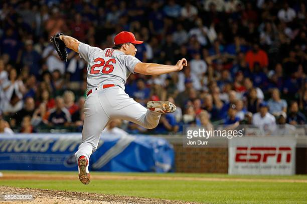 Seung Hwan Oh of the St Louis Cardinals goes airborne after his last pitch to strike out Dexter Fowler of the Chicago Cubs during the ninth inning at...