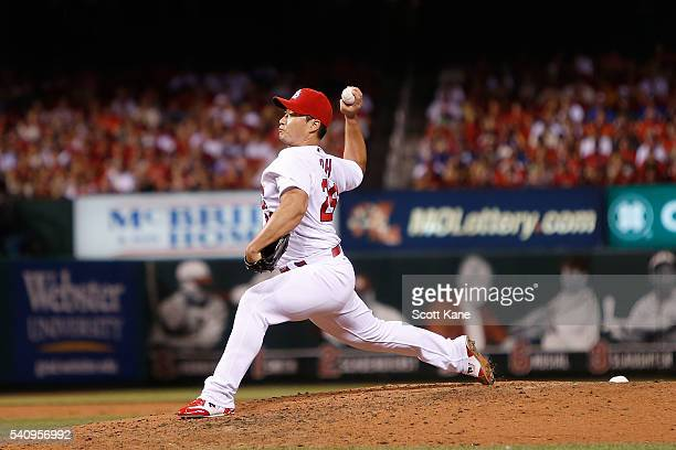 Seung Hwan Oh of the St Louis Cardinals pitches against the Texas Rangers during the eighth inning of a baseball game at Busch Stadium on June 17...