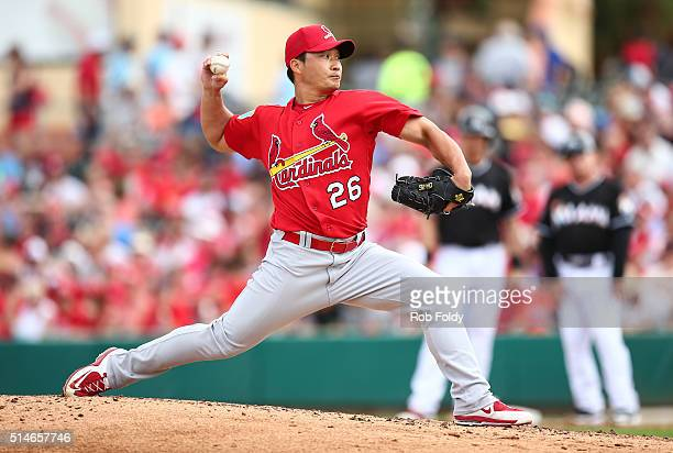Seung Hwan Oh of the St Louis Cardinals pitches during the spring training game against the Miami Marlins on March 5 2016 in Jupiter Florida
