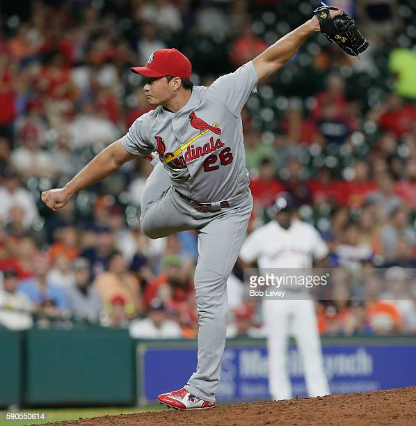 Seung Hwan Oh of the St Louis Cardinals pitches in the ninth inning against the Houston Astros at Minute Maid Park on August 16 2016 in Houston Texas