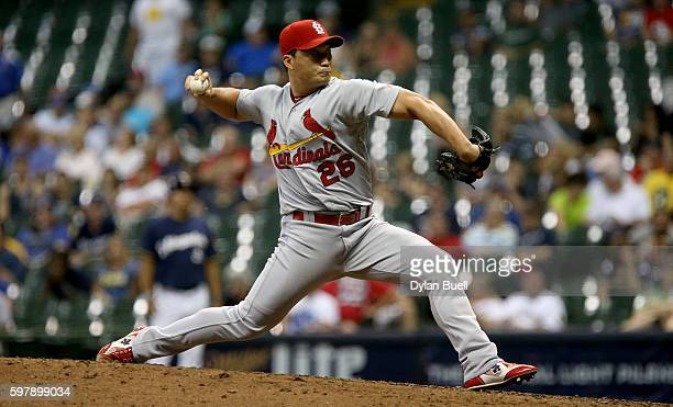 Seung Hwan Oh of the St Louis Cardinals pitches in the ninth inning against the Milwaukee Brewers at Miller Park on August 29 2016 in Milwaukee...