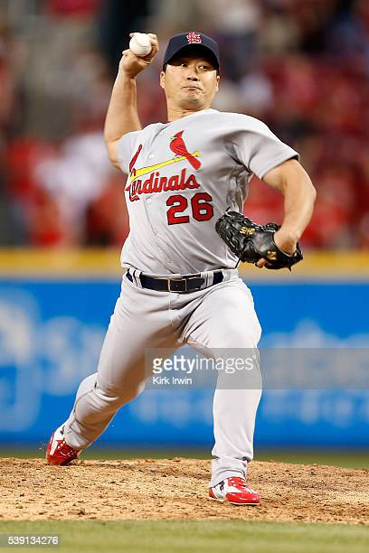Seung Hwan Oh of the St Louis Cardinals throws a pitch during the seventh inning of the game against the Cincinnati Reds at Great American Ball Park...