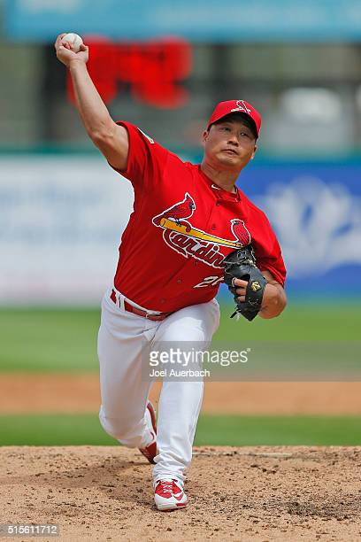 Seung Hwan Oh of the St Louis Cardinals throws the ball against the Minnesota Twins in the sixth inning of a spring training game at Roger Dean...