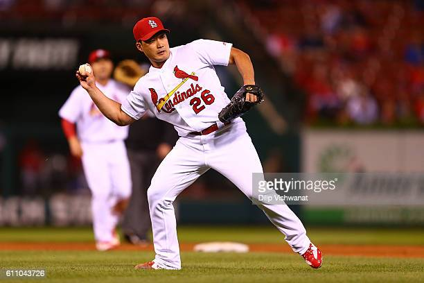 Seung Hwan Oh of the St Louis Cardinals throws to first base against the Cincinnati Reds in the ninth inning at Busch Stadium on September 28 2016 in...