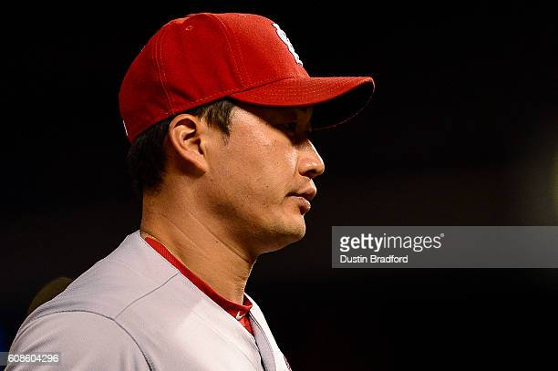 Seung Hwan Oh of the St Louis Cardinals walks toward the dugout after a game against the Colorado Rockies at Coors Field on September 19 2016 in...