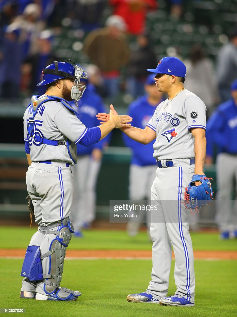 Seung Hwan Oh #22 of the Toronto Blue Jays is congratulated by Russell Martin #55 for closing out the game for the win against the Texas Rangers at Globe Life Park in Arlington on April 6, 2018 in Arlington, Texas.