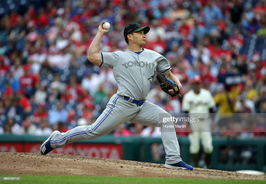 Seung Hwan Oh #22 of the Toronto Blue Jays throws a pitch in the seventh inning during a game against the Philadelphia Phillies at Citizens Bank Park on May 27, 2018 in Philadelphia, Pennsylvania. The Blue Jays won 5-3.