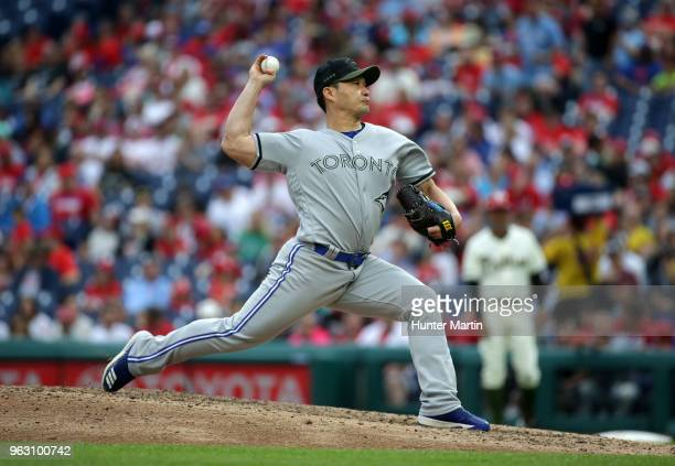 Seung Hwan Oh of the Toronto Blue Jays throws a pitch in the seventh inning during a game against the Philadelphia Phillies at Citizens Bank Park on...